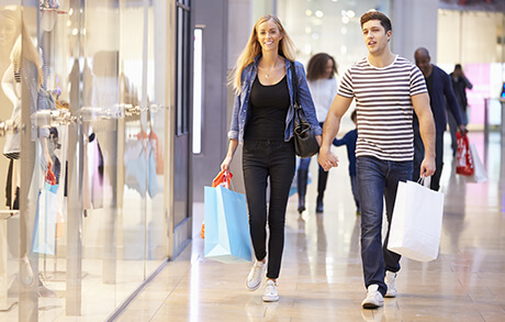 Shoppers walking at Hulen Mall