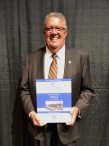 Bob Baulsir accepting CLIDE Award for TEXRail Project