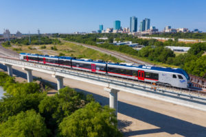 TEXRail Train riding on elevated track