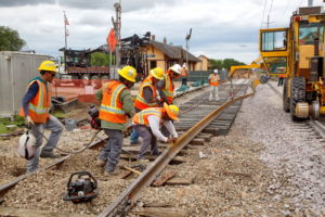 Construction workers working on the new train tracks in Grapevine, Texas