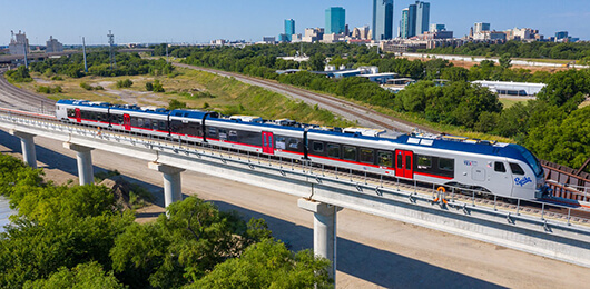 TEXRail train with downtown Fort Worth in background