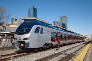 TEXRail train at FWCS with Downtown Fort Worth in background