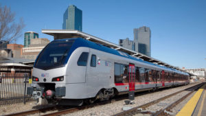 TEXRail train at Fort Worth Central Station with downtown Fort Worth high rise towers in the background