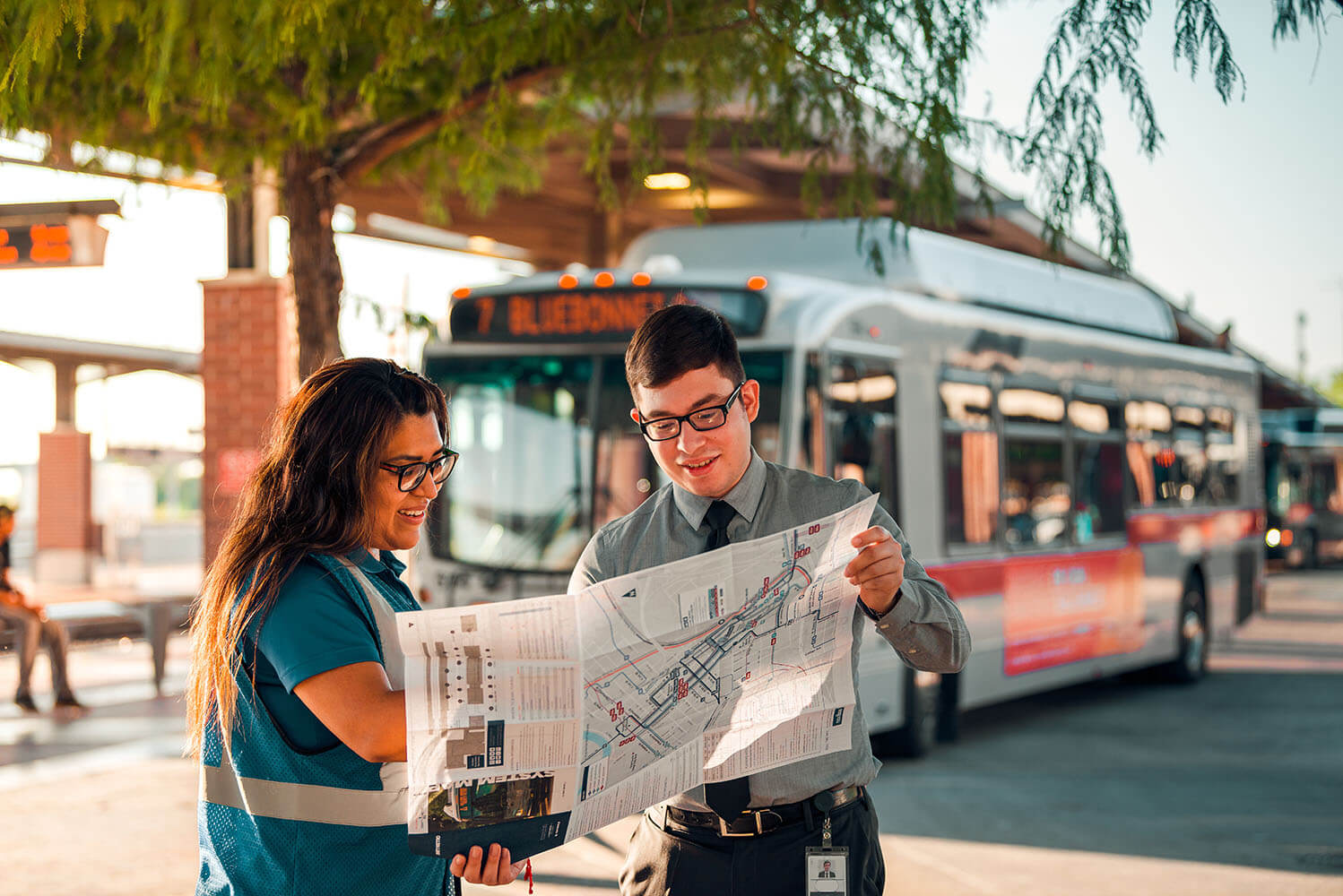 Two people searching a transit map